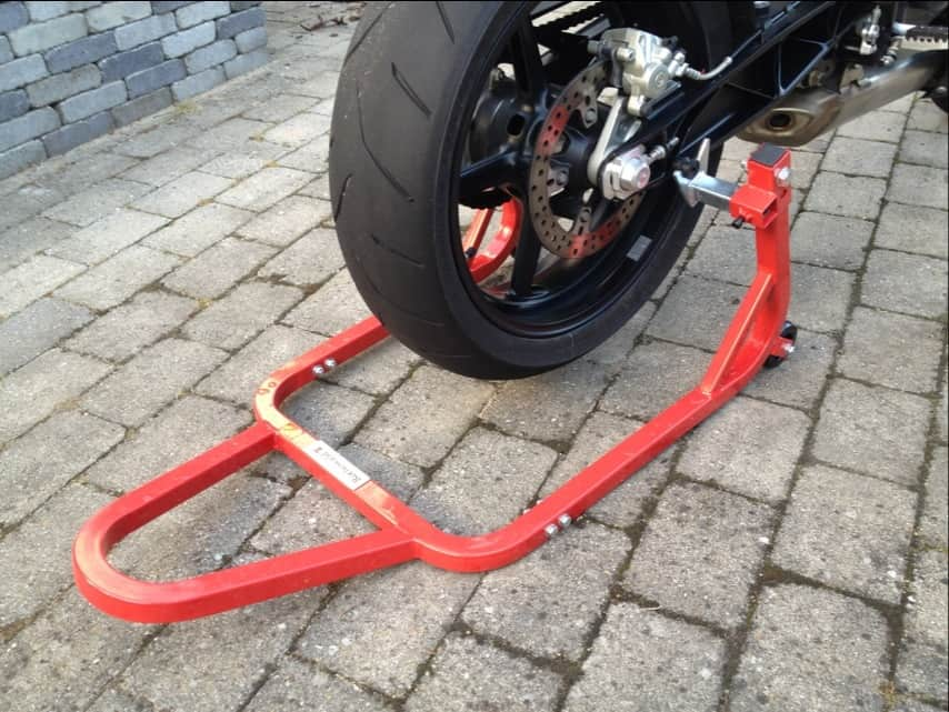 how to put a motorcycle on its center stand